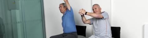 Exercise training for two male patients post-stroke.